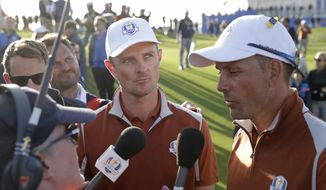 FILE - In this Sept. 29, 2018 file photo, Europe's Justin Rose, center, and Europe's Henrik Stenson are interviewed after winning a foursome match on the second day of the 42nd Ryder Cup at Le Golf National in Saint-Quentin-en-Yvelines, outside Paris, France. The PGA Tour is experimenting this year on whether to have short interviews with players during their rounds. (AP Photo/Matt Dunham, File)