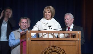 New Mexico Gov. Michelle Lujan Grisham gives her inaugural address after receiving her oath of office during the inaugural ceremony in Santa Fe, N.M., Tuesday, Jan. 1, 2019. (Eddie Moore/The Albuquerque Journal via AP)