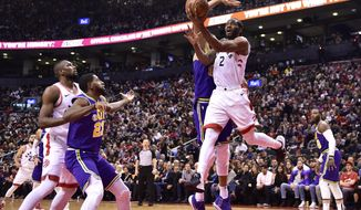 Toronto Raptors forward Kawhi Leonard (2) scores against the Utah Jazz during the second half of an NBA basketball game Tuesday, Jan. 1, 2019, in Toronto. (Frank Gunn/The Canadian Press via AP)