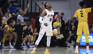 St. John's guard Shamorie Ponds winces after missing a shot during the first half of an NCAA college basketball game against Marquette on Tuesday, Jan. 1, 2019, in New York. (AP Photo/Kevin Hagen).