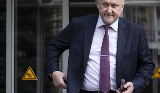 """FILE - In this Sept. 20, 2018, file photo, Yuri Ganus, head of the Russian Anti-Doping Agency, leaves an office building in Moscow. The deadline for Russia to turn over samples and other data from its Moscow anti-doping lab has passed, leaving the World Anti-Doping Agency to decide whether to reinstate the ban it had lifted in September. As the deadline approached and no progress was reported, Ganus appealed to president Vladimir Putin to help resolve the issue. """"We're standing on the edge of the abyss, and I'm asking you to protect the present and the future of our clean sports, the current and future generations of athletes,"""" Ganus said in a letter addressed to Putin last week. (AP Photo/Alexander Zemlianichenko, File)"""