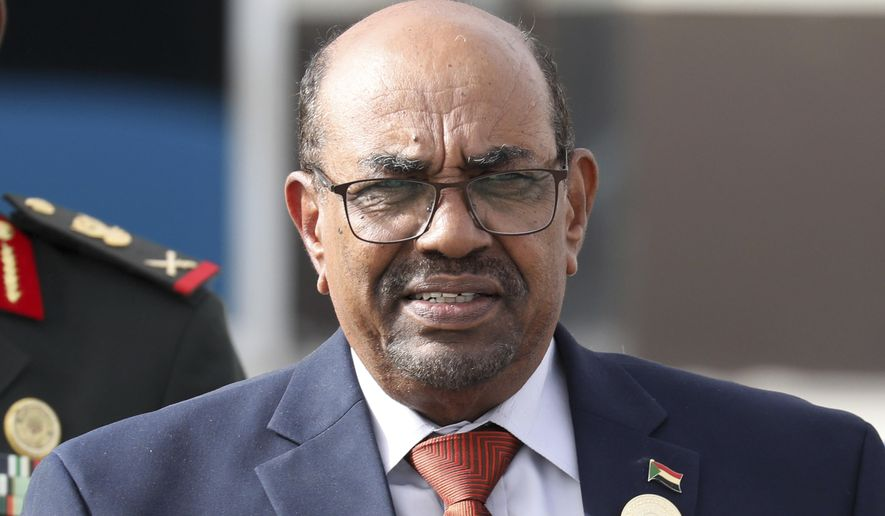 "In this July 2, 2018 file photo, Sudanese President Omar al-Bashir leaves the African Union summit, in Nouakchott, Mauritania. Sudan's president has ordered an investigation into ""recent events"" in the country, a reference to two weeks of violent protests against his 29-year rule. The country's state news agency, reported late on Monday, Dec. 31, 2018, that al-Bashir tasked Justice Minister Mohammed Ahmed Salem with leading the probe committee. The move likely reflects efforts by al-Bashir to placate popular anger over his autocratic rule and economic policies. (Ludovic Marin/Pool Photo via AP, File)"