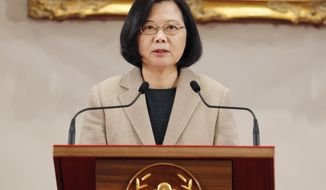 Taiwanese President Tsai Ing-wen delivers a speech during the New Year press conference in Taipei, Taiwan, Tuesday, Jan. 1, 2019. Taiwan's leader said Tuesday the people of the island want to maintain self-rule despite recent electoral gains by the Beijing-friendly opposition party. Taiwanese officials should not enter into any secret dialogue with China, President Tsai warned in a New Year's speech.(AP Photo/Chiang Ying-ying)