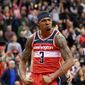 Washington Wizards guard Bradley Beal (3) reacts after making a basket during triple overtime of an NBA basketball game against the Phoenix Suns, Saturday, Dec. 22, 2018, in Washington. Beal had 40 points and his first career triple-double and the Wizards won 149-146 in triple-overtime. (AP Photo/Nick Wass) **FILE**