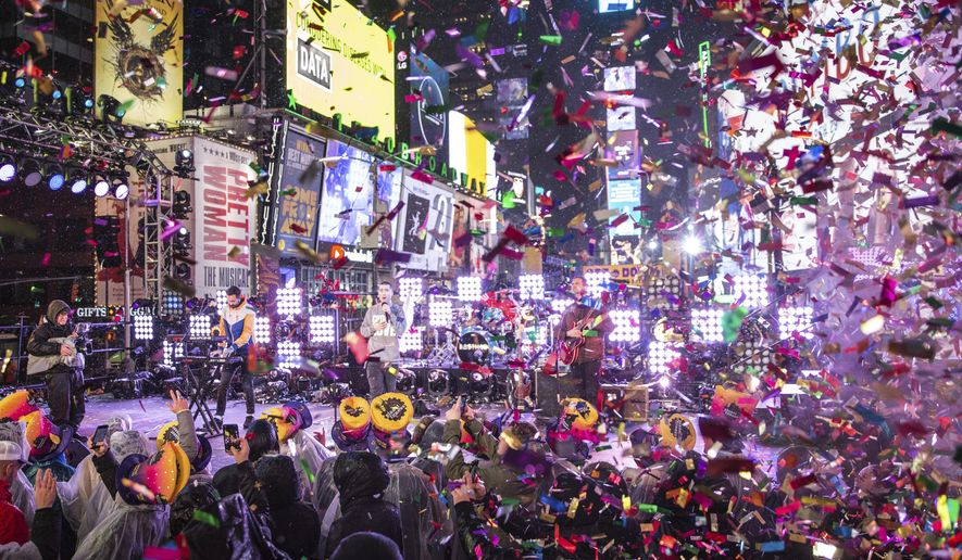 Bastille performs on stage at the New Year's Eve celebration in Times Square on Monday, Dec. 31, 2018, in New York. (Photo by Joe Russo/Invision/AP)