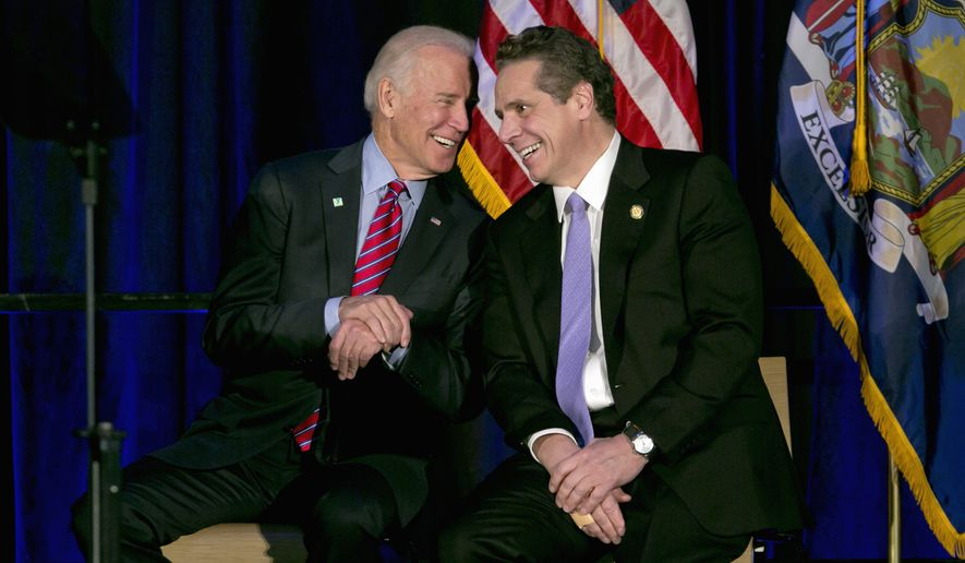 Then-Vice President Joe Biden (left) talks with New York Gov. Andrew Cuomo during a rally on the economy,  Friday, Jan. 29, 2016, in New York. (AP Photo/Richard Drew) ** FILE **