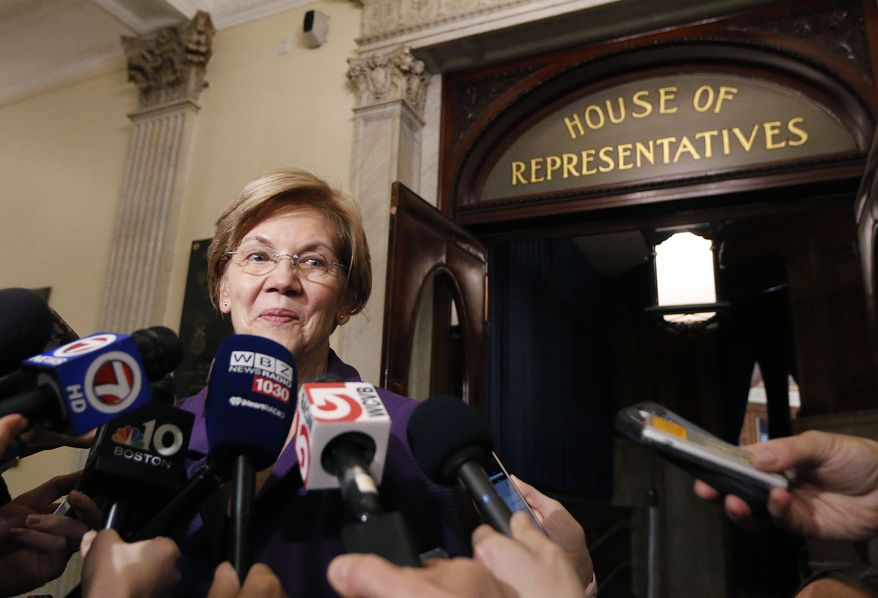 Sen. Elizabeth Warren, D-Mass., speaks to reporters at the Massachusetts Statehouse, Wednesday, Jan. 2, 2019, in Boston. Warren has taken the first major step toward launching a widely anticipated campaign for the presidency, hoping her reputation as a populist fighter can help her navigate a Democratic field that could include nearly two dozen candidates. (AP Photo/Elise Amendola)