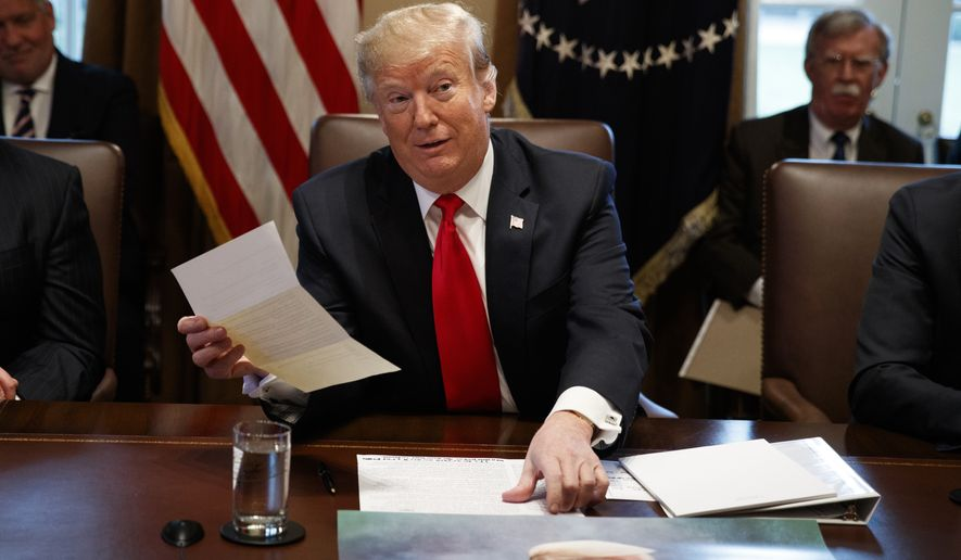President Donald Trump holds up a letter he says is from North Korean leader Kim Jong Un during a cabinet meeting at the White House, Wednesday, Jan. 2, 2019, in Washington. (AP Photo/Evan Vucci)
