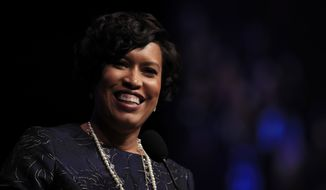District of Columbia Mayor Muriel Bowser speaks after being is sworn in as the seventh elected mayor of the District of Columbia and the first woman to ever be re-elected to the office during a ceremony at the Washington Convention Center, in Washington, Wednesday, Jan. 2, 2019. (AP Photo/Manuel Balce Ceneta)