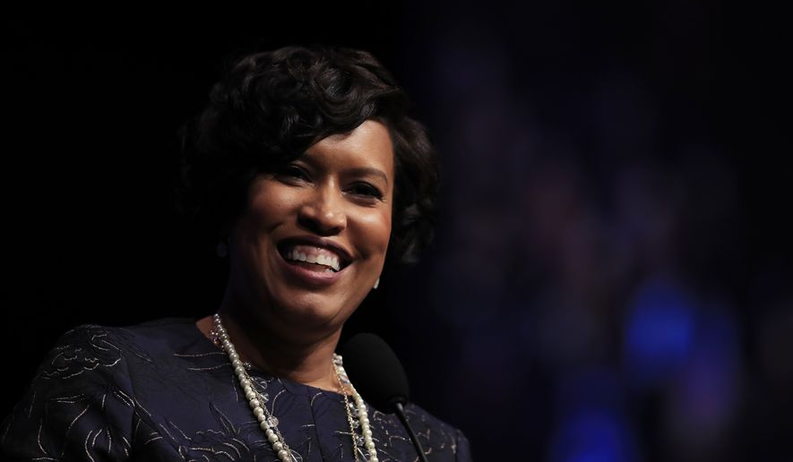 District of Columbia Mayor Muriel Bowser speaks after being is sworn in as the seventh elected mayor of the District of Columbia and the first woman to ever be re-elected to the office during a ceremony at the Washington Convention Center, in Washington, Wednesday, Jan. 2, 2019. (AP Photo/Manuel Balce Ceneta) **FILE**