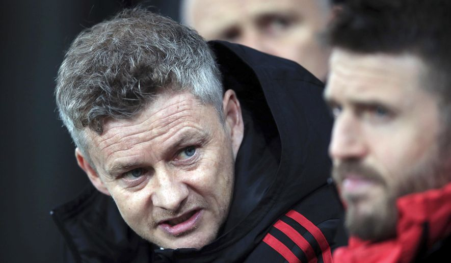 Manchester United interim manager Ole Gunnar Solskjaer, left, speaks with coach Michael Carrick during a Premier League soccer match against Newcastle United at St James' Park, Wednesday, Jan. 2, 2019, in Newcastle, England. (Owen Humphreys/PA via AP)
