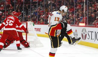 Calgary Flames left wing Johnny Gaudreau (13) celebrates his goal in the third period of an NHL hockey game against the Detroit Red Wings, Wednesday, Jan. 2, 2019, in Detroit. (AP Photo/Paul Sancya)