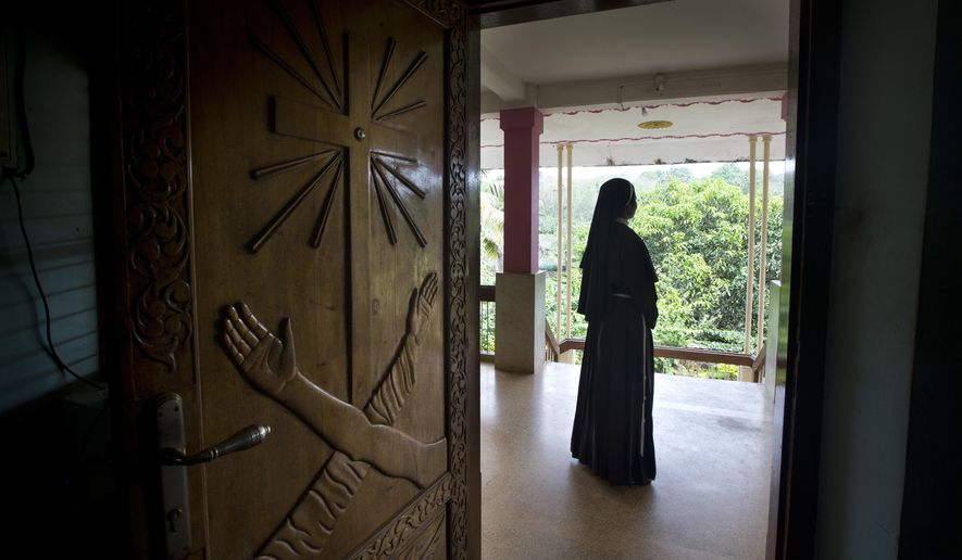 In this Saturday, Nov. 3, 2018, photo, a Catholic nun stands at the foyer of the St. Francis Mission Home in Kuravilangad in the southern Indian state of Kerala. For decades, nuns in India have quietly endured sexual pressure from Catholic priests, an AP investigation has revealed. (AP Photo/Manish Swarup)