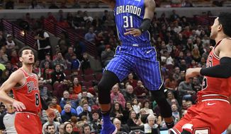 Orlando Magic guard Terrence Ross (31) goes to the basket as Chicago Bulls guard Zach LaVine (8) stands nearby during the first half of an NBA basketball game Wednesday, Jan. 2, 2019 in Chicago. (AP Photo/David Banks)