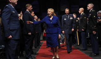 Janet Mills reacts as she greets a friend at her inauguration ceremony, Wednesday, Jan. 2, 2019, at the Augusta Civic Center in Augusta, Maine. Mills, a Democrat, is the state's first female governor. (AP Photo/Robert F. Bukaty)