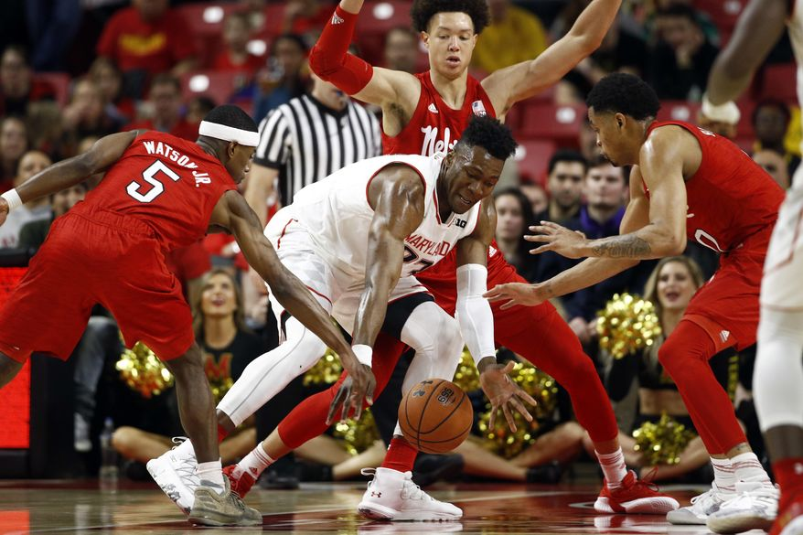 Maryland forward Bruno Fernando, center, of Angola, tries to maintain possession of the ball as he is surrounded by Nebraska guard Glynn Watson Jr., from left, forward Isaiah Roby and guard James Palmer in the first half of an NCAA college basketball game, Wednesday, Jan. 2, 2019, in College Park, Md. (AP Photo/Patrick Semansky)