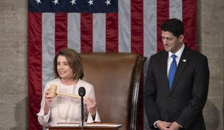 In this file photo from Tuesday, Jan. 3, 2017, House Democratic Leader Nancy Pelosi of California, left, joins Speaker of the House Paul Ryan, R-Wis., at the start of the 115th Congress, at the Capitol in Washington. The Republicans will relinquish the majority to House Democrats under leadership of Nancy Pelosi as speaker on Thursday, Jan. 3, 2019, beginning a new era of divided government. (AP Photo/J. Scott Applewhite, file)