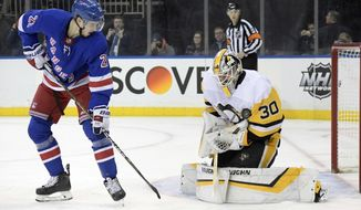 Pittsburgh Penguins goaltender Matt Murray (30) makes a save as New York Rangers center Brett Howden (21) looks for a rebound during the second period of an NHL hockey game Wednesday, Jan. 2, 2019, at Madison Square Garden in New York. (AP Photo/Bill Kostroun)