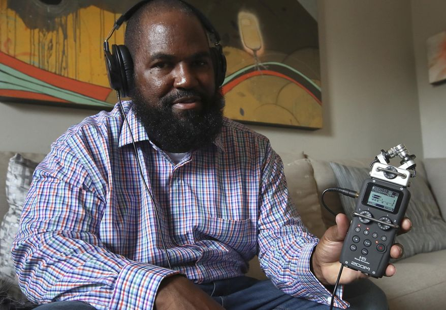 In this Dec. 19, 2018, photo, Earlonne Woods shows recording equipment similar to what he used in San Quentin State Prison to produce his podcasts, during an interview in Oakland, Calif. Woods, 47, was recently released from San Quentin prison after California Gov. Jerry Brown commuted his 31-years-to-life sentence for attempted armed robbery. (AP Photo/Ben Margot)