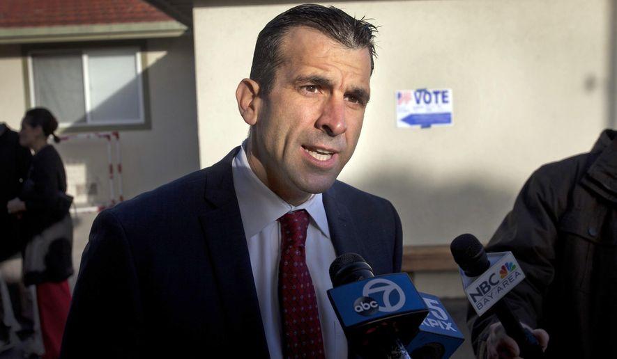 FILE - In this Nov. 4, 2014. file photo, San Jose mayor Sam Liccardo talks with reporters after dropping off his ballot on election day in San Jose, Calif. Liccardo is recovering in a hospital after being struck by an SUV while bicycling on New Year's Day. (Patrick Tehan/San Jose Mercury News via AP, File)