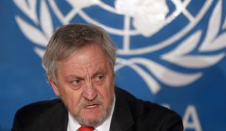 FILE - In this Wednesday, Feb. 18, 2015, file photo, Nicholas Haysom, then the top UN envoy in Afghanistan, speaks during a press conference in Kabul. Somalia's government on Tuesday, Jan. 1, 2019 ordered Nicholas Haysom, the United Nations envoy to Somalia, to leave amid questions over the arrest of the al-Shabab extremist group's former deputy leader Mukhtar Robow who had run for a regional presidency. (AP Photo/Massoud Hossaini, File)