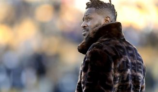 In this photo from Dec. 30, 2018, Pittsburgh Steelers wide receiver Antonio Brown stands on the sideline before an NFL football game against the Cincinnati Bengals, in Pittsburgh. Pittsburgh Steelers head coach Mike Tomlin says he's disappointed in the behavior of star wide receiver Antonio Brown but added the team has not received any formal trade request from Brown's camp. (AP Photo/Don Wright) ** FILE **