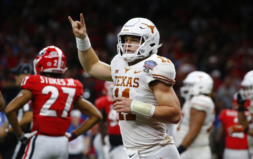 Texas quarterback Sam Ehlinger (11) celebrates his second touchdown carry in the first half of the Sugar Bowl NCAA college football game against Georgia in New Orleans, Tuesday, Jan. 1, 2019. (AP Photo/Butch Dill)