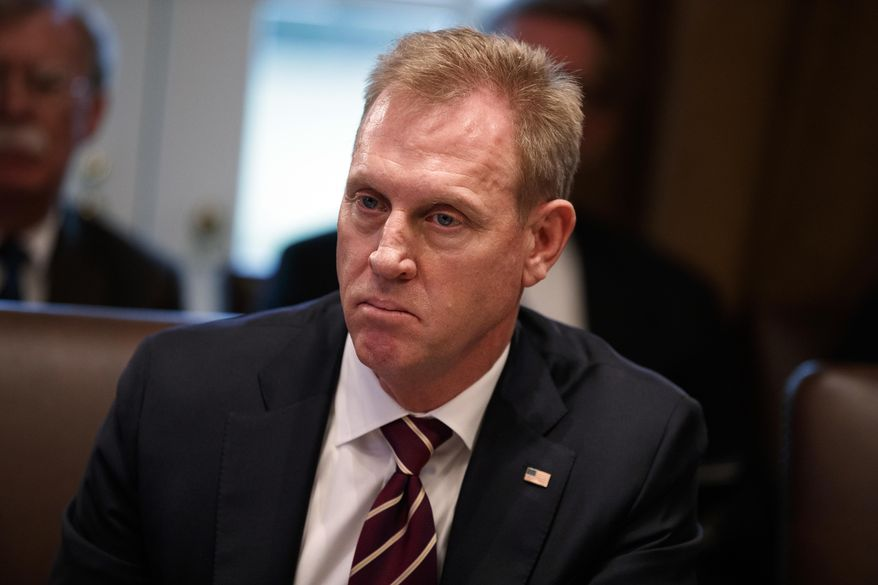 Acting Secretary of Defense Patrick Shanahan listens as President Donald Trump speaks during a cabinet meeting at the White House, Wednesday, Jan. 2, 2019, in Washington. (AP Photo/Evan Vucci)