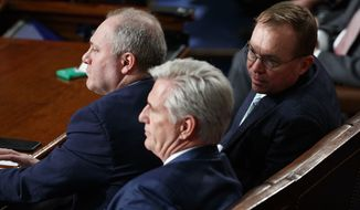 White House Chief of Staff Mick Mulvaney, right, talks with Rep. Kevin McCarthy of Calif., center and Rep. Steve Scalise, R-La., before House Democratic Leader Nancy Pelosi of California is sworn in a House Speaker at the U.S. Capitol in Washington, Thursday, Jan. 3, 2019. (AP Photo/Carolyn Kaster)