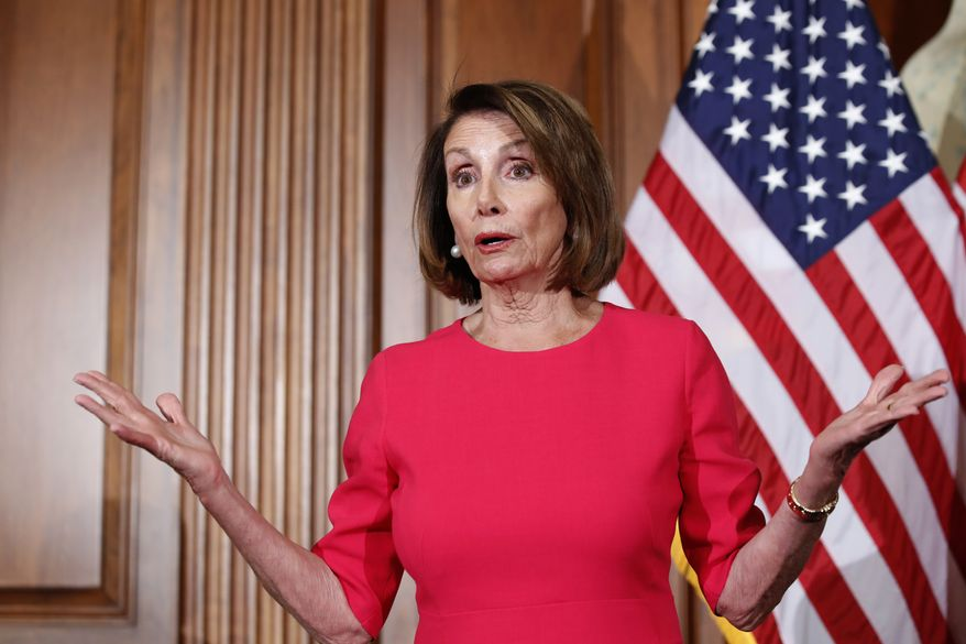 House Speaker Nancy Pelosi of Calif., gestures while speaking before a ceremonial swearing-in, on Capitol Hill, Thursday, Jan. 3, 2019 in Washington, during the opening session of the 116th Congress. (AP Photo/Alex Brandon)