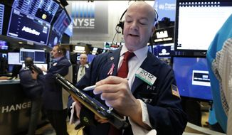 Trader Patrick Casey works on the floor of the New York Stock Exchange, Thursday, Jan. 3, 2019. Apple's shock warning that its Chinese sales are weakening ratcheted up concerns about the world's second largest economy and weighed heavily on global stock markets as well as the dollar on Thursday. (AP Photo/Richard Drew)