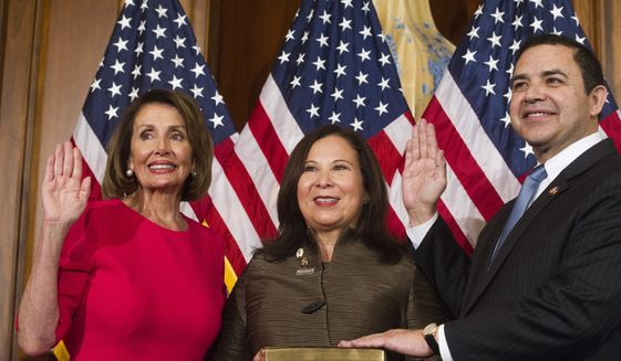 House Speaker Nancy Pelosi of Calif., right, poses during a ceremonial swearing-in with Rep. Henry Cuellar, D-Texas, right, on Capitol Hill in Washington, Thursday, Jan. 3, 2019, during the opening session of the 116th Congress. Washington, Thursday, Jan. 3, 2019. (AP Photo/Cliff Owen)