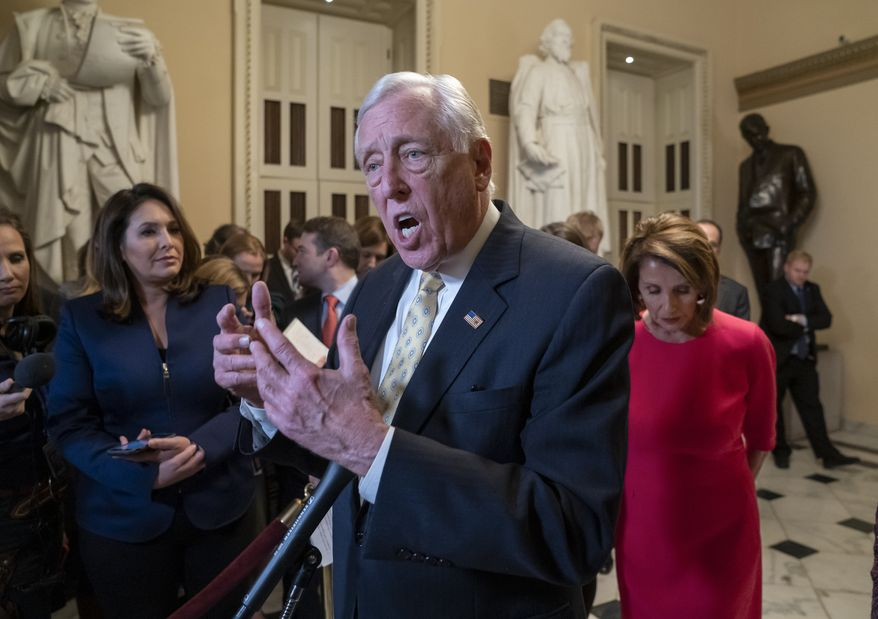 House Majority Leader Steny Hoyer, D-Md., center, and Speaker of the House Nancy Pelosi, D-Calif., push back on President Donald Trump's demand for funding to build a wall on the US-Mexico border as the partial government shutdown is in its second week, at the Capitol in Washington, Thursday, Jan. 3, 2019. (AP Photo/J. Scott Applewhite) ** FILE **
