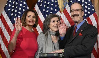 House Speaker Nancy Pelosi of Calif., left, poses during a ceremonial swearing-in with Rep. Eliot Engel, D-N.Y., right, on Capitol Hill in Washington, Thursday, Jan. 3, 2019, during the opening session of the 116th Congress. (AP Photo/Susan Walsh) ** FILE **