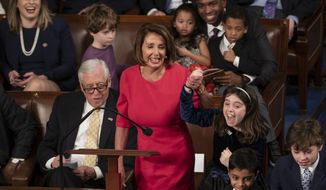 With some enthusiastic assistance from her grandchildren, House Democratic Leader Nancy Pelosi of California smiles as she casts her vote for herself to be speaker of the House on the first day of the 116th Congress, at the Capitol in Washington, Thursday, Jan. 3, 2019. (AP Photo/J. Scott Applewhite)