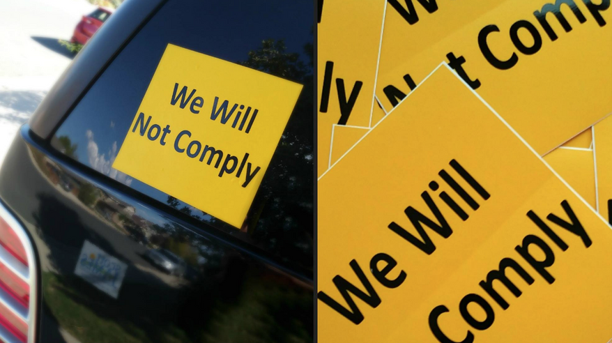 "Stickers with the message, ""We Will Not Comply"" have popped up on vehicles, guitar cases, even rifle bags. (Photo courtesy Rally for Our Rights)"
