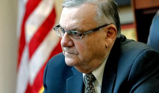 FILE - In this Jan. 10, 2018 file photo, former Maricopa County Sheriff Joe Arpaio speaks at his office in Fountain Hills, Ariz. The Justice Department won't appeal the court-ordered appointment of a special prosecutor to defend a ruling that refused to erase Arpaio's criminal record after he was pardoned. The special prosecutor's appointment came after the Justice Department refused to defend a judge's ruling that dismissed the lawman's case but refused to expunge his record. (AP Photo/Matt York, File)