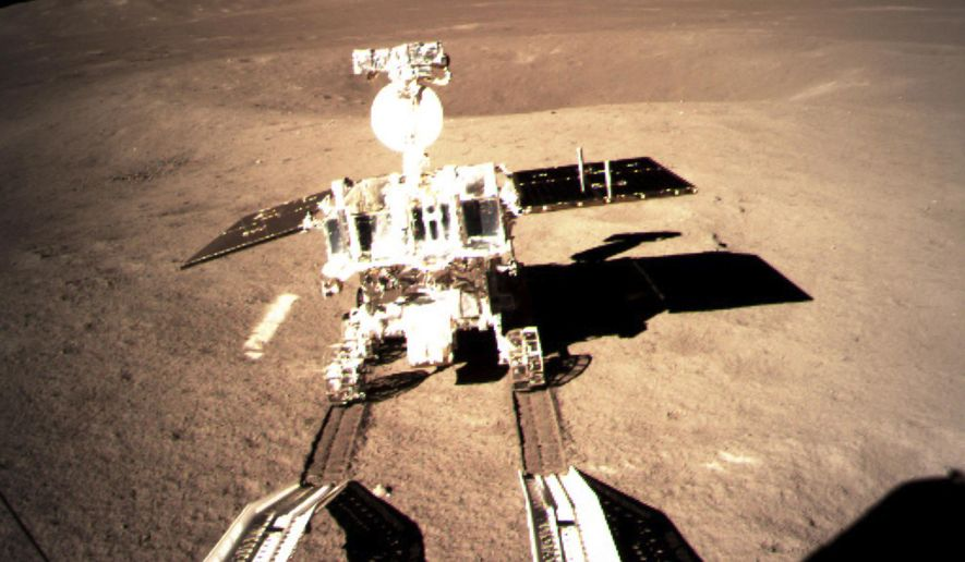 China's lunar rover leaves wheel marks after leaving the lander that touched down on the surface of the far side of the moon. A Chinese spacecraft on Thursday, Jan. 3, made the first-ever landing on the far side of the moon, state media said. The lunar explorer Chang'e 4 touched down at 10:26 a.m., China Central Television said in a brief announcement at the top of its noon news broadcast. (China National Space Administration/Xinhua News Agency via AP)