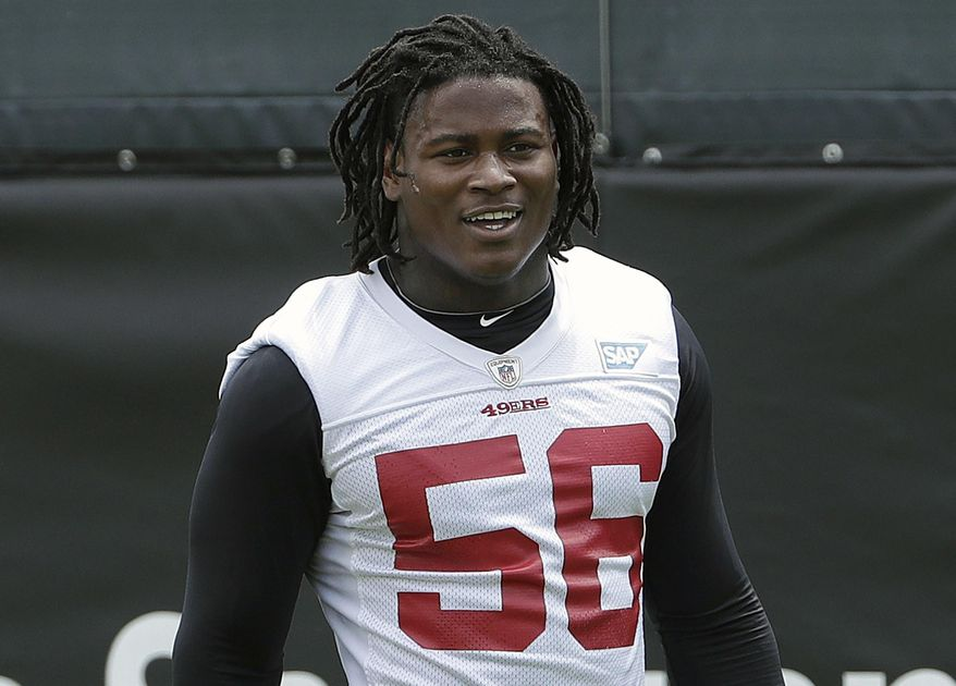 In this May 30, 2018, file photo, then-San Francisco 49ers linebacker Reuben Foster walks on the field during a practice at the team's NFL football training facility in Santa Clara, Calif.  Prosecutors in Florida have decided not to pursue a domestic violence charge against NFL player Reuben Foster more than a month after he was released from the San Francisco 49ers following his arrest. Prosecutors in Tampa filed a notice of termination of prosecution on Wednesday, Jan. 2, 2019. (AP Photo/Jeff Chiu) ** FILE **