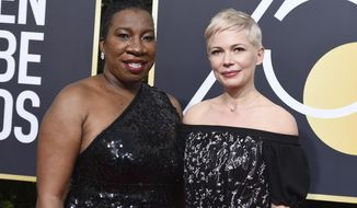 FILE - In this Jan. 7, 2018 file photo, social activist and founder of the #MeToo movement, Tarana Burke, left, and actress Michelle Williams wear black at the 75th annual Golden Globe Awards in Beverly Hills, Calif.   The Golden Globe Awards last year set the tone for how the film awards season would address the #MeToo movement, and as the hours tick down to Sunday, Jan. 6, 2019 show, many in Hollywood are wondering what this year will have in store. (Photo by Jordan Strauss/Invision/AP, File)