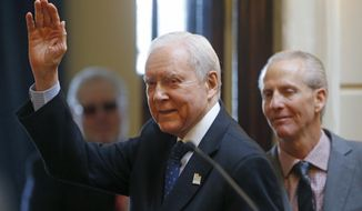 FILE - In this Feb. 21, 2018, file photo, Sen. Orrin Hatch, R-Utah, waves after addresses the Utah Senate while Senate President Wayne Niederhauser, R-Sandy, looks on at the Utah State Capitol, in Salt Lake City.  Hatch is ending his tenure as the longest-serving Republican senator in history, Thursday, Jan. 3, 2019, capping a unique career that positioned him as one of the most prominent conservative voices in the United States.  (AP Photo/Rick Bowmer, File)