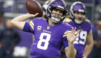 FILE - In this Sunday, Dec. 30, 2018 file photo, Minnesota Vikings quarterback Kirk Cousins warms up before an NFL football game against the Chicago Bears, Sunday, Dec. 30, 2018, in Minneapolis. Giving quarterbacks big money doesn't guarantee success or even playoff appearances. The NFL's six highest-paid quarterbacks in 2018 will be spectators this postseason. Green Bay's Aaron Rodgers ($33.5 million), Atlanta's Matt Ryan ($30 million), Minnesota's Kirk Cousins ($28 million), San Francisco's Jimmy Garoppolo ($27.5 million), Detroit's Matthew Stafford ($27 million) and Oakland's Derek Carr ($25 million) couldn't lead their teams to the playoffs. (AP Photo/Bruce Kluckhohn) ** FILE **