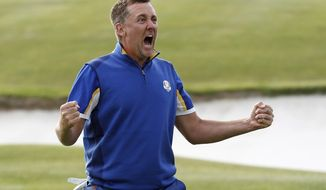 FILE - In this Sept. 30, 2018, file photo, Europe's Ian Poulter celebrates after defeating Dustin Johnson of the United States during a singles match on the final day of the 42nd Ryder Cup at Le Golf National in Saint-Quentin-en-Yvelines, France. Poulter is in Hawaii to start the new year, part of a bizarre set of circumstances where winning caused him to add two tournaments to his schedule. (AP Photo/Laurent Cipriani, File)