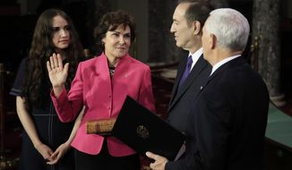 Vice President Mike Pence administers a ceremonial Senate oath during a mock swearing-in ceremony to Sen. Jacky Rosen, D-Nev., accompanied by her family Thursday, Jan. 3, 2019, in the Old Senate Chamber on Capitol Hill in Washington. (AP Photo/Manuel Balce Ceneta)
