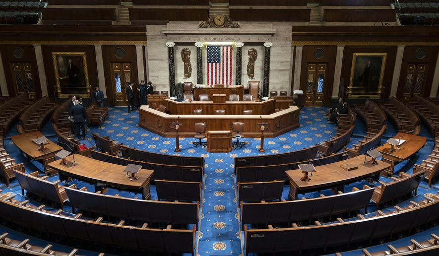 The chamber of the House of Representatives is seen before convening for the first day of the 116th Congress with Democrats holding the majority, at the Capitol in Washington, Thursday, Jan. 3, 2019. (AP Photo/J. Scott Applewhite)