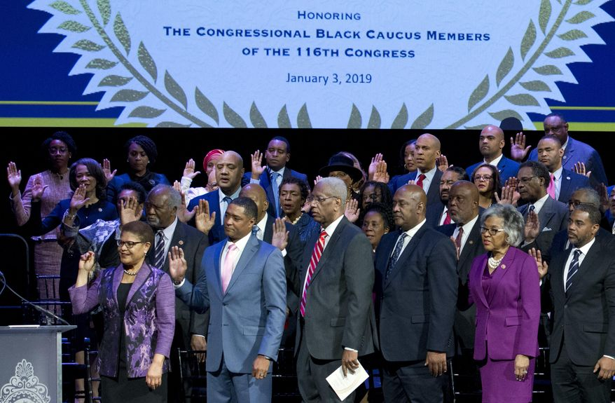 Members of the Congressional Black Caucus raise their hands during the swearing-in ceremony of CBC members at The Warner Theatre in Washington, Thursday, Jan. 3, 2019. (AP Photo/Jose Luis Magana) ** FILE **