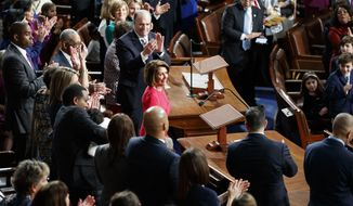 House Democratic Leader Nancy Pelosi of California, who is expected to lead the 116th Congress as speaker of the House, is applauded at the Capitol in Washington, Thursday, Jan. 3, 2019.  (AP Photo/Carolyn Kaster)