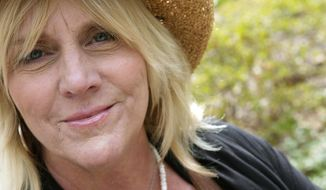 FILE - In this April 17, 2007 file photo, singer Pegi Young is photographed in New York's Central Park.  Young, who with fellow musician and then-husband Neil Young helped found the Bridge School for children with speech and physical impairments, has died. Young died of cancer Tuesday, Jan. 1, 2019, in California, according to spokeswoman Michelle Gutenstein-Hinz. She was 66.  (AP Photo/ Jim Cooper, File)