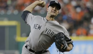 FILE - In this Saturday, Oct. 14, 2017 file photo, New York Yankees relief pitcher David Robertson throws during the seventh inning of Game 2 of baseball's American League Championship Series against the Houston Astros in Houston. Reliever David Robertson and the Philadelphia Phillies have agreed to a $23 million, two-year contact. The 33-year-old right-hander went 8-3 with a 3.23 ERA and five saves in 69 games last season for the New York Yankees.  (AP Photo/Tony Gutierrez, File)