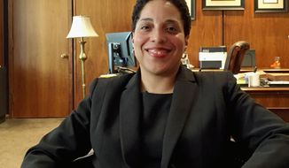 FILE - In this May 16, 2018, file photo, St. Louis Circuit Attorney Kim Gardner poses for a photo in her office in St. Louis. Gardner has been fined $63,000 by the Missouri Ethics Commission for violations that include using campaign funds for personal expenses. Gardner, a Democrat, blamed the commission's interest on a Republican political operative. (AP Photo/Jim Salter, File)